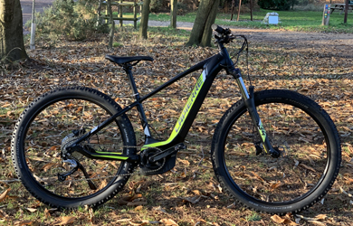 "26"" wheel off-road useable electric bikes complete with panniers & 25-mile range"